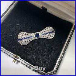 Antique 20s Art Deco 14K gold diamonds and sapphire bow brooch pin