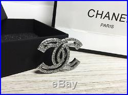Breastpin Chanel 17 Outline Cutout Crystal CC Logo 18K White Gold Brooch Pin