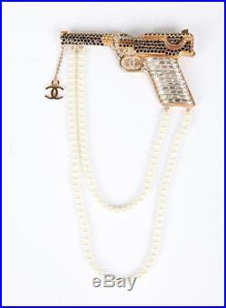 CHANEL 2001 RARE Goldtone Gold Crystal Rhinestone Pearl Strand Gun Brooch Pin