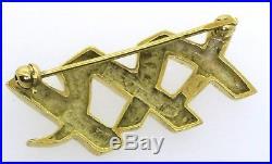 Tiffany & Co. Paloma Picasso 18K gold elegant high fashion XXX pin/brooch
