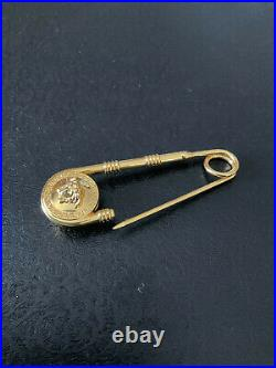 Versace Medusa safety pin brooch. Women. Brass
